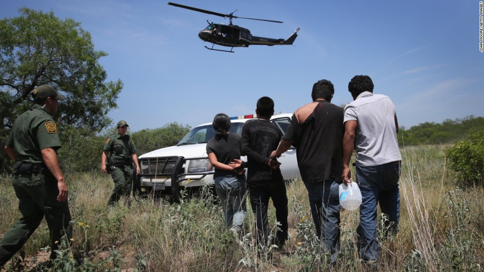 "Agents with U.S. Customs and Border Protection take undocumented immigrants into custody Tuesday, July 22, near Falfurrias, Texas. Texas Gov. Rick Perry announced July 21 that he will deploy up to 1,000 National Guard troops to the <a href=""http://www.cnn.com/2014/07/22/politics/gallery/border-crisis/index.html"">Texas-Mexico border</a>, where tens of thousands of unaccompanied minors from Central America have crossed into the United States this year. <a href=""http://www.cnn.com/2014/07/18/world/gallery/week-in-photos-0718/index.html "">See last week in 33 photos</a>"