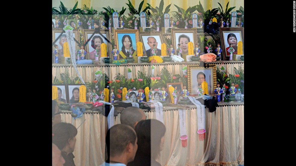 On July 24, relatives of passengers pray at an altar set up for the victims.