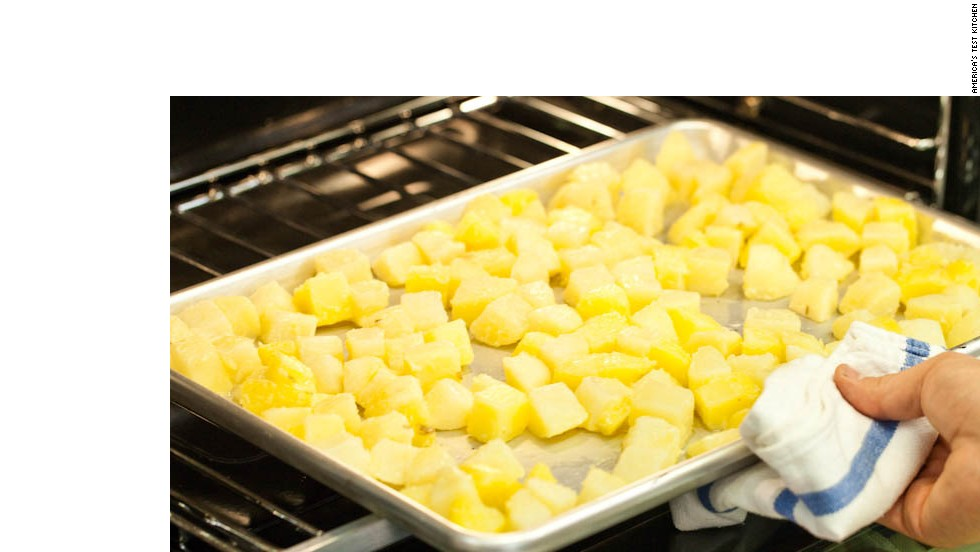 7. Transfer potatoes to baking sheet and spread into even layer. Roast for 15 minutes.