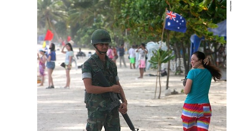 Post coup, soldiers were a common sight on the beaches of Phuket following government ordered cleanups.