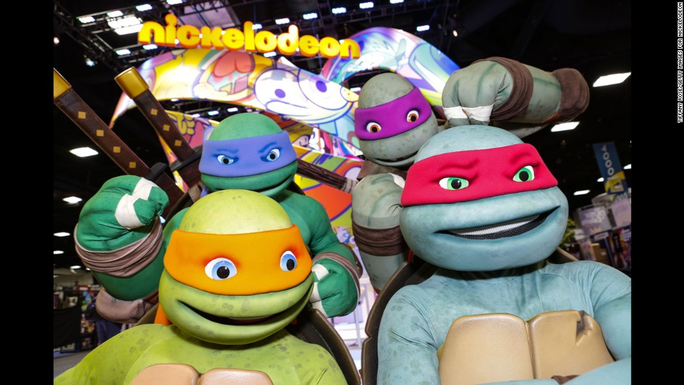 The Teenage Mutant Ninja Turtles pose at the Nickelodeon booth on July 24.