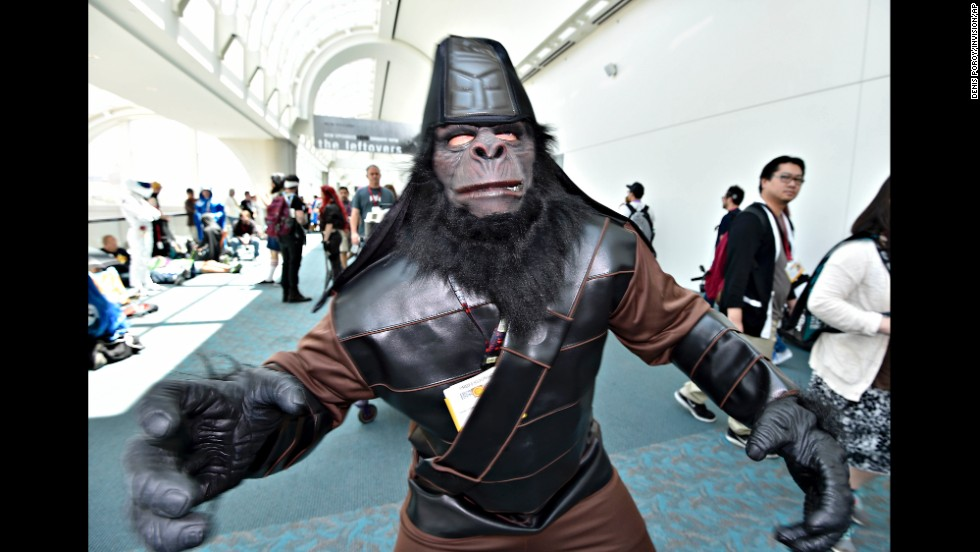 "A fan dressed as a character from ""Planet of the Apes"" walks inside the convention center on July 26."