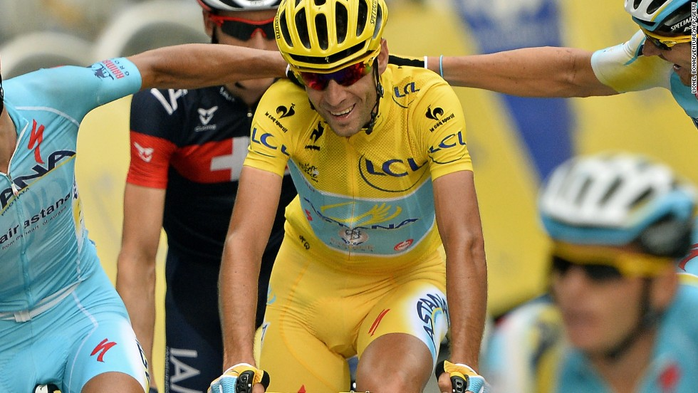 Nibali is congratulated by his Astana teammates after completing his yellow jersey triumph on the Tour de France.