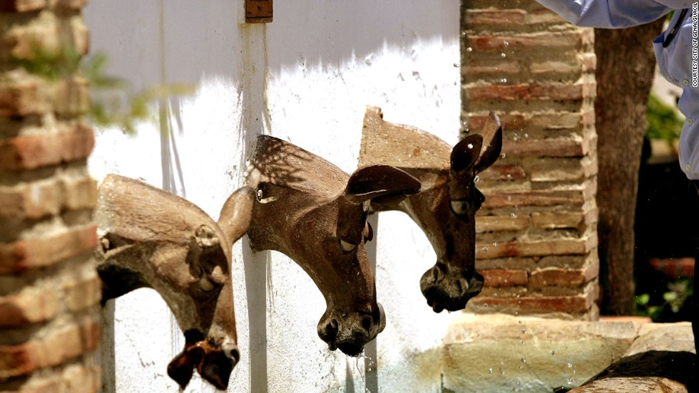 """The town's streets and contemporary arts museum are now filled with dozens of works, including this water fountain titled """"Acemilas"""" -- or mules -- by Juan Ramon Gimeno."""