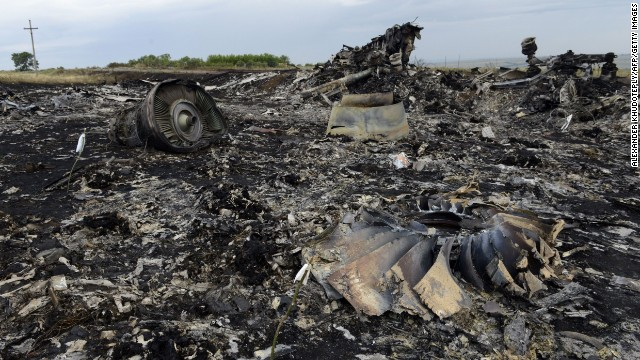 Debris lies at the site of the crash of a Malaysia Airlines plane carrying 298 people from Amsterdam to Kuala Lumpur in Grabove, in rebel-held east Ukraine, on July 19, 2014. Ukraine and pro-Russian insurgents agreed on July 19 to set up a security zone around the crash site of a Malaysian jet whose downing in the rebel-held east has drawn global condemnation of the Kremlin. Outraged world leaders have demanded Russia's immediate cooperation in a prompt and independent probe into the shooting down on July 17 of flight MH17 with 298 people on board. AFP PHOTO/ ALEXANDER KHUDOTEPLY        (Photo credit should read Alexander KHUDOTEPLY/AFP/Getty Images)