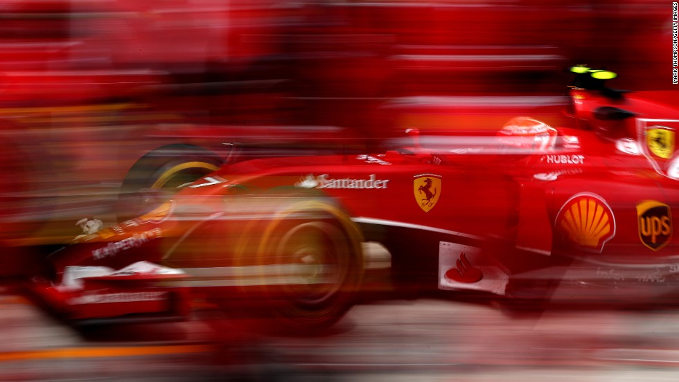 A slow shutter speed was used to snap this photo of Formula One driver Kimi Raikkonen as he made a pit stop Sunday, July 27, during the Hungarian Grand Prix in Budapest, Hungary. Raikkonen finished sixth in the race, which was won by Daniel Ricciardo.