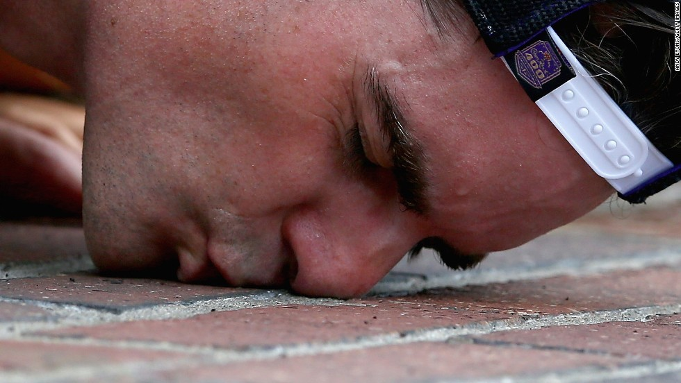 NASCAR driver Jeff Gordon celebrates a victory Sunday, July 27, by kissing the brick finish line at Indianapolis Motor Speedway. It was a NASCAR-record fifth win at the track for Gordon, who was raised in Indiana.