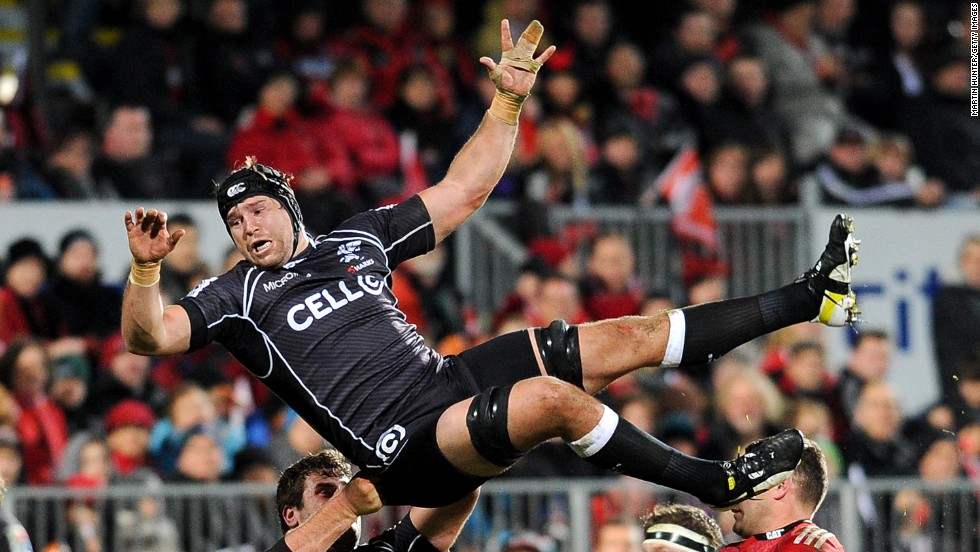 Willem Alberts of the Sharks, a South African rugby team, loses control of the ball during a Super Rugby semifinal match against the Crusaders on Saturday, July 26, in Christchurch, New Zealand. The New Zealand-based Crusaders won 38-6 to advance to the Super Rugby final against the Australia-based Waratahs.
