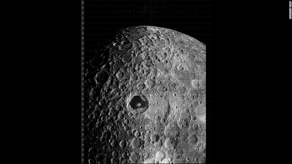 The prominent feature in this image, taken by the Lunar Orbiter 3 on 19 February 1967, is Tsiolkovskiy, a large impact crater located on the far side of the Moon.