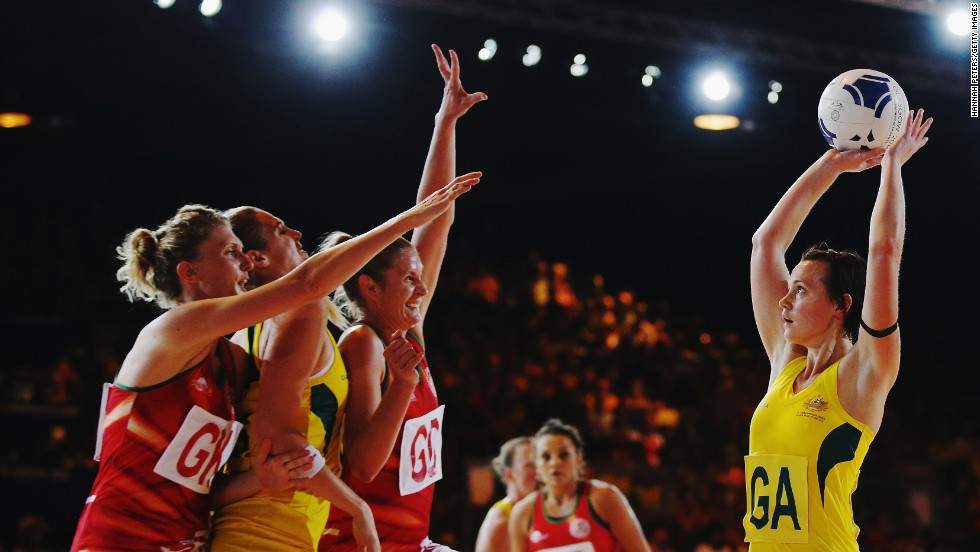 Australian netball player Natalie Medhurst shoots during a preliminary round game against Wales on Thursday, July 24, during the Commonwealth Games in Glasgow, Scotland. Australia won 63-36.