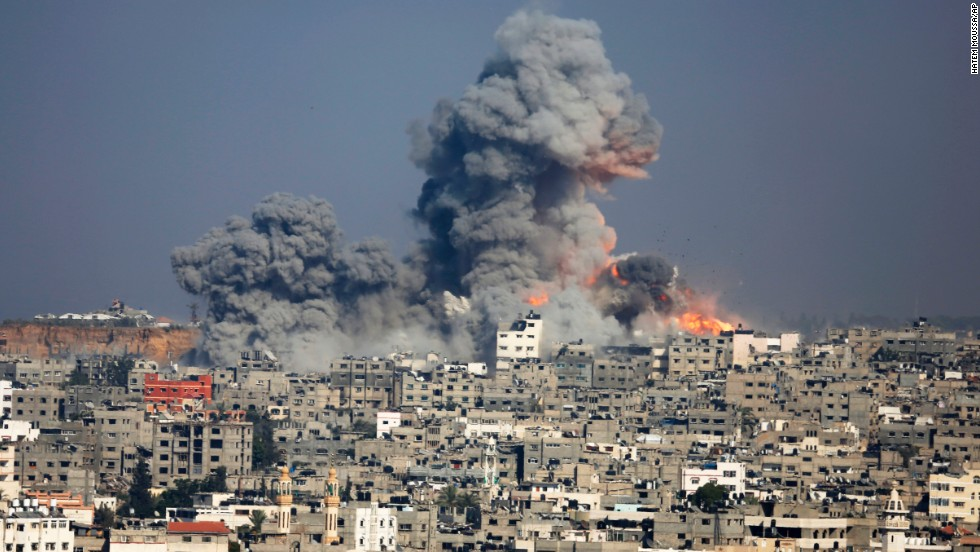 Smoke and fire rise above Gaza City after an Israeli airstrike on July 29.