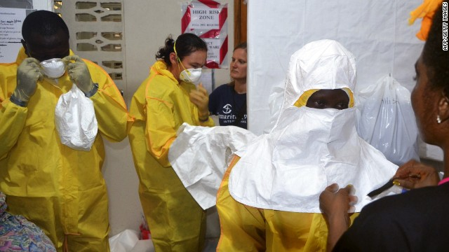 A picture taken on July 24, 2014 shows staff of the Christian charity Samaritan's Purse putting on protective gear in the ELWA hospital in the Liberian capital Monrovia.