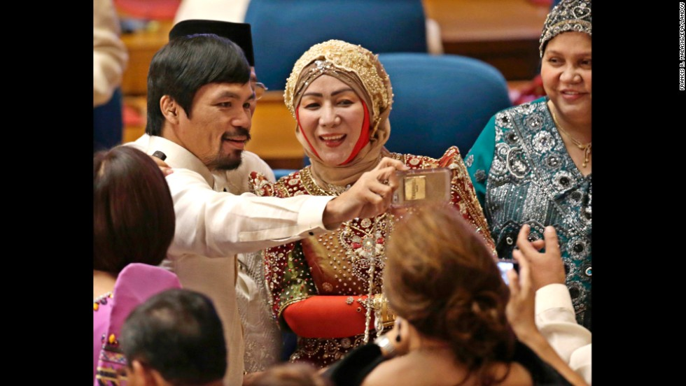 Boxing champion Manny Pacquiao takes a selfie with fellow Philippine lawmakers before a joint session of Congress on Monday, July 28, in Manila, Philippines. Pacquiao was elected to the Philippine House of Representatives in 2010.