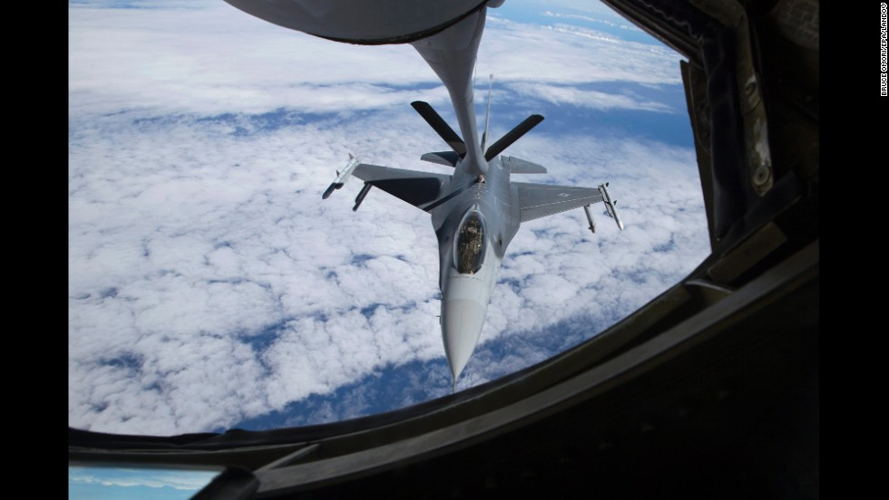 "An American F-16 jet moves into position beneath a KC-135 ""Stratotanker"" for a refueling mission July 23, in the airspace west of Hawaii."