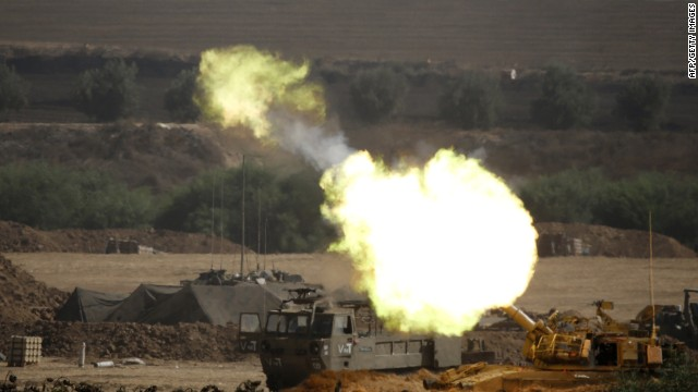 An Israeli artillery gun fires a 155mm shell towards targets from their position near Israel's border with the Gaza Strip on July 30, 2014