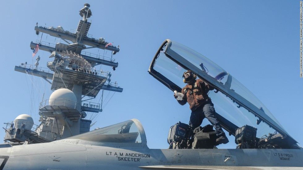 Airman Antony Hopson cleans the cockpit of an F/A-18 Super Hornet aboard the USS Ronald Reagan on July 26.