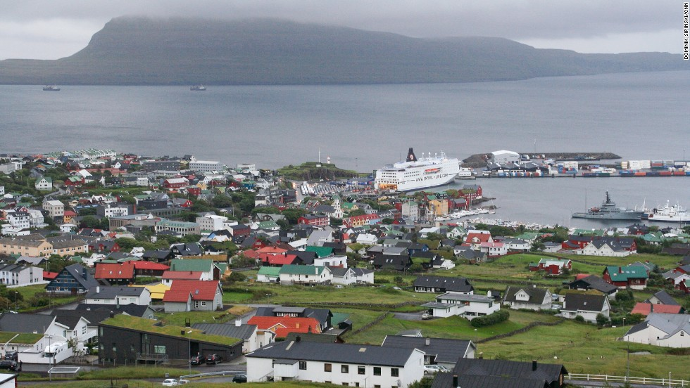 In Torshavn harbor, a Smyril Line ship has just arrived from Denmark, bringing tourists for a three-day stopover on their way to Iceland.
