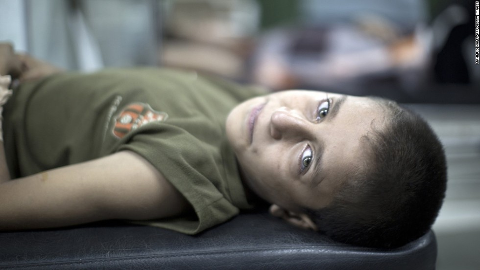 "A Palestinian boy waits for treatment at a hospital in Beit Lahia after being wounded during an early morning airstrike <a href=""http://www.cnn.com/2014/07/18/world/gallery/israel-gaza/index.html"" target=""_blank"">at a school-turned-shelter</a> in northern Gaza on Wednesday, July 30. The United Nations blamed Israel for the attack after <a href=""http://www.cnn.com/2014/07/18/world/gallery/israel-gaza/index.html"" target=""_blank"">Israel launched a ground operation in Gaza</a> on Thursday, July 17, after a 10-day campaign of airstrikes failed to halt relentless Hamas rocket fire on Israeli cities."