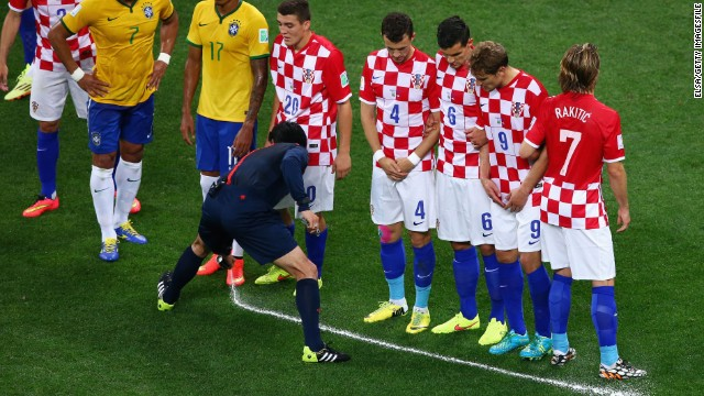 A referee uses the vanishing spray in the opening match of the World Cup between Brazil and Croatia.