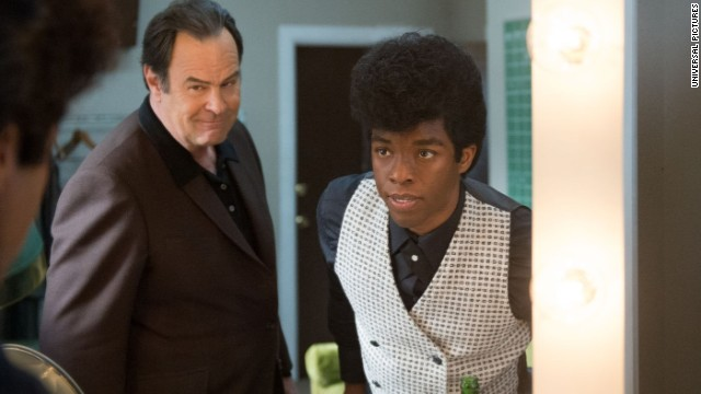 "Dan Aykroyd, left, plays Ben Bart in ""Get On Up"" along with Chadwick Boseman as James Brown."