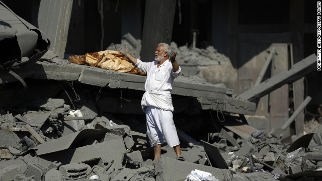 A Palestinian man reacts as he stands on the rubble of his home in Jabalia in the northern Gaza Strip on August 1, 2014.