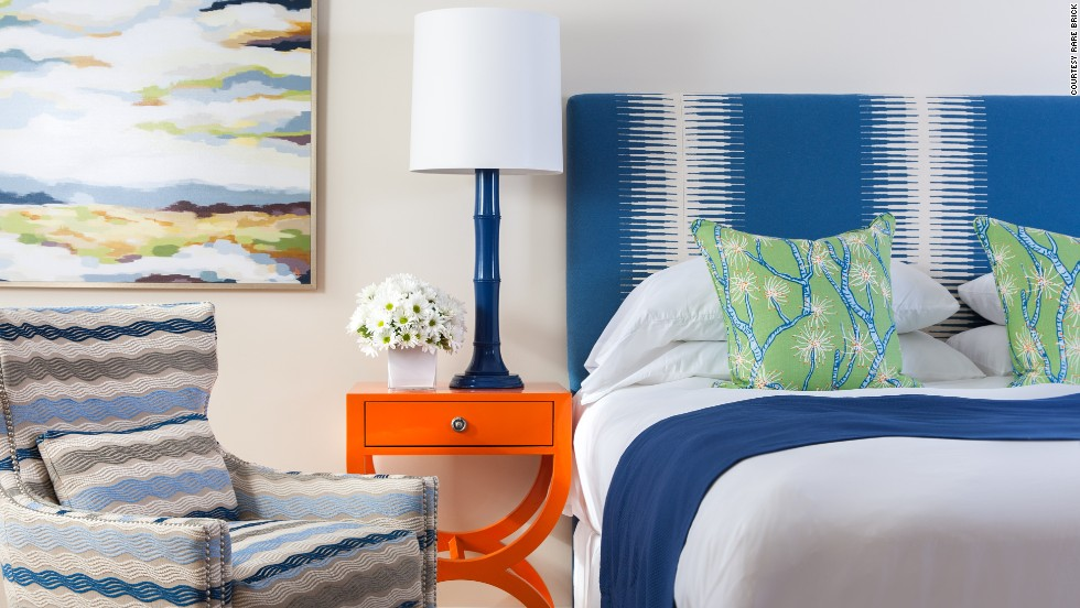 At The Break in Narragansett, Rhode Island, colorful hues highlight each of the 16 rooms, including coral-motif pillows and nightstands the color of tangerines that exude a mid-century vibe.