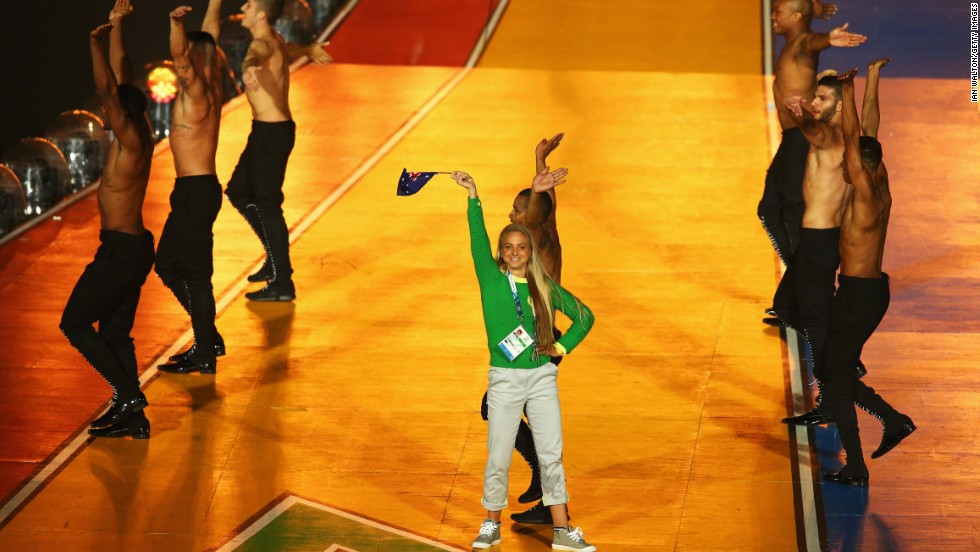 "Australian runner Genevieve LaCaze crashed the stage during Minogue's performance, dancing and waving an Australian flag before being removed by security. ""It was my 25th birthday,"" she<a href=""http://www.abc.net.au/local/photos/2014/08/04/4060171.htm"" target=""_blank""> told ABC</a>. ""I just saw the opportunity to get on stage with Kylie."""