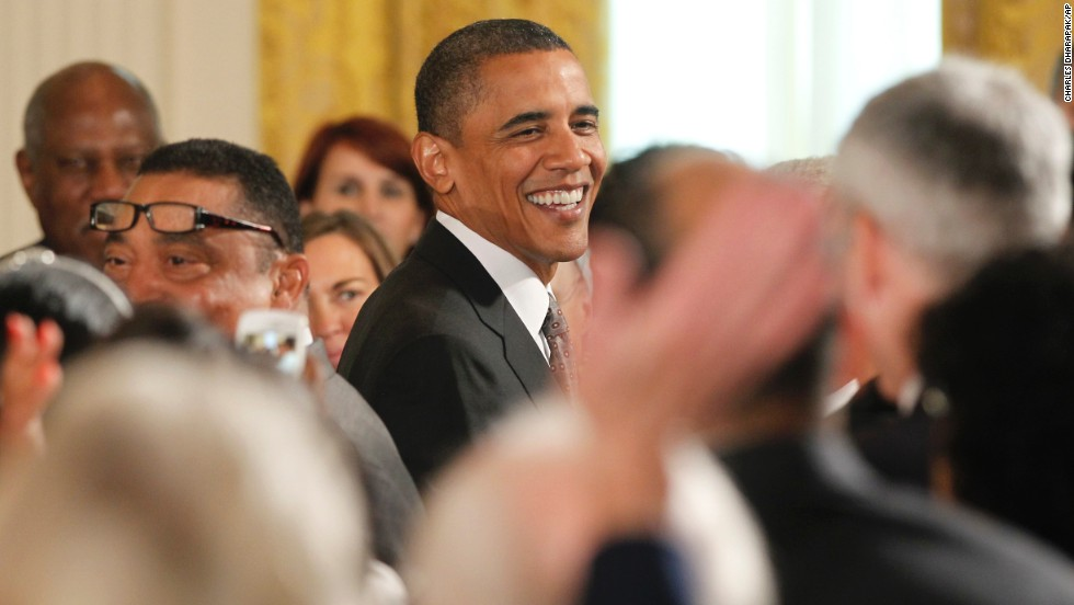 "President Barack Obama reacts as the audience sings ""Happy Birthday"" after he presented the 2010 Citizens Medals at the White House. (AP Photo/Charles Dharapak)"