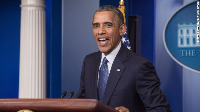 US President Barack Obama acknowledges early birthday wishes after making a statement in the briefing room of the White House on August 1, 2014 in Washington. Obama turns 53 on August 4.