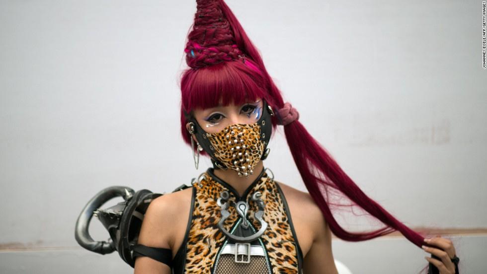 A woman cosplayer poses while she waits to go on stage.