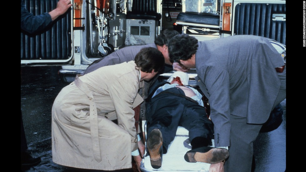 Brady is placed into an ambulance shortly after being shot. He suffered a head wound and was left partially paralyzed.