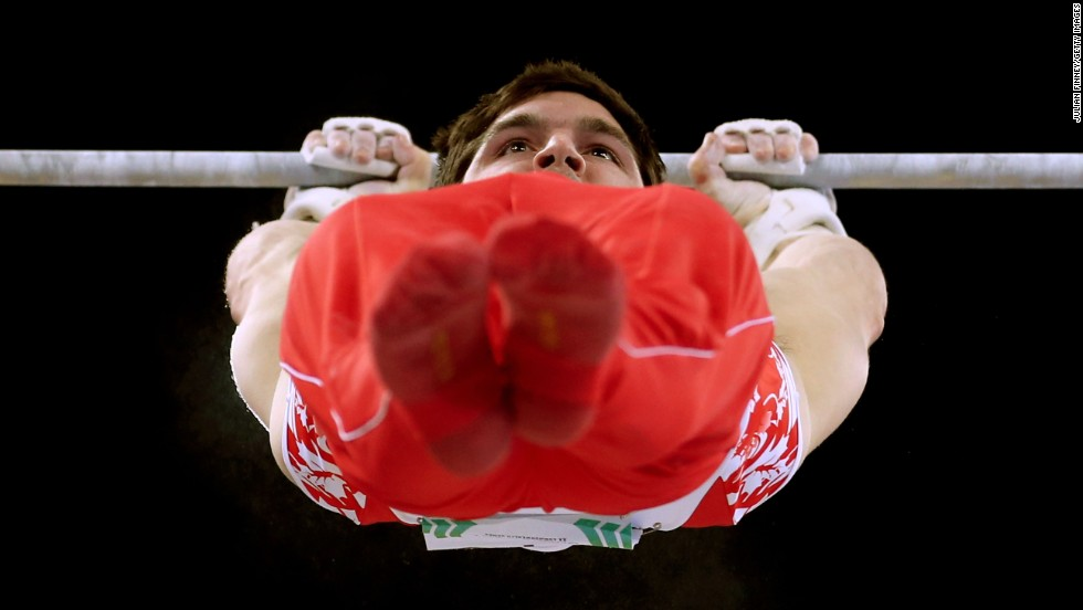 Kevin Lytwyn of Canada competes in the final of the horizontal bar, or high bar, during the Commonwealth Games in Glasgow, Scotland, on Friday, August 1. He won the bronze medal in the event. England's Nile Wilson won gold.