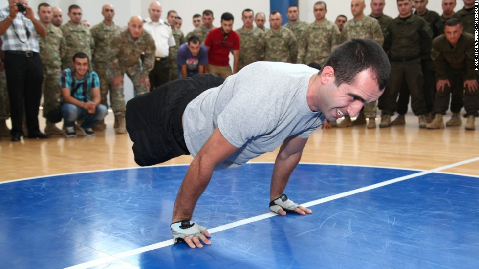 Georgian soldier Temur Dadiani, a double amputee, sets a Guinness World Record by doing 36 planche pushups in 38.25 seconds Sunday, August 3, at the Ministry of Defence in Tbilisi, Georgia. Dadiani lost his legs in 2011 after an explosion in Afghanistan.