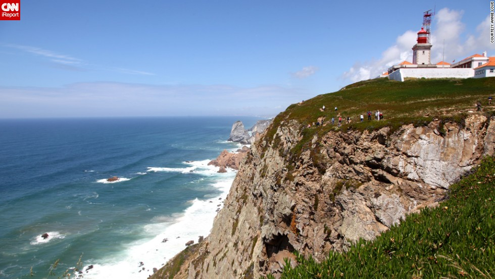 """This lighthouse overlooks the scenic shore of Cabo da Roca, Portugal, in a photo taken by <a href=""""http://ireport.cnn.com/docs/DOC-1157305"""">Annie Love</a>. """"On my first trip to Portugal, my friends and I were geocaching (using a GPS for a scavenger hunt of sorts) in the Lisbon area and decided to find the geocache at the westernmost point of continental Europe. The geocache brought us there, but the stunning views and neat hiking trails around the lighthouse kept us exploring for a bit. I returned to the lighthouse this past June, which is when I snapped the photo."""""""