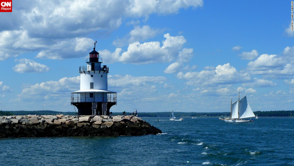 "This lighthouse is smaller than most, and it captured <a href=""http://ireport.cnn.com/docs/DOC-1157099"">Mary Umbricht's</a> attention while visiting Portland, Maine. She is proud of the results: ""It was the combination of the clouds, blue sky, the sailboat and how they all came together that I liked about this photo."""