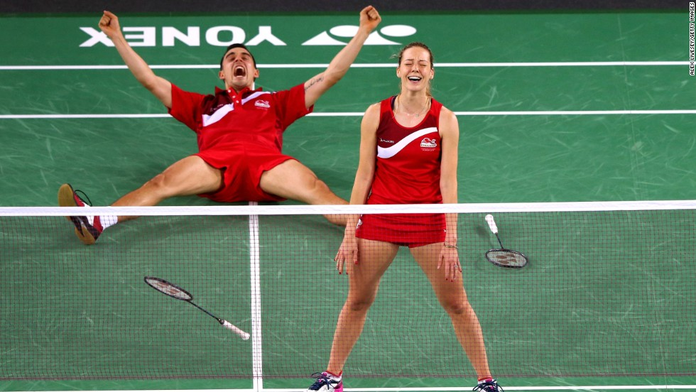 English badminton players Gabrielle and Chris Adcock celebrate Sunday, August 3, after winning the gold medal in mixed doubles at the Commonwealth Games in Glasgow, Scotland.