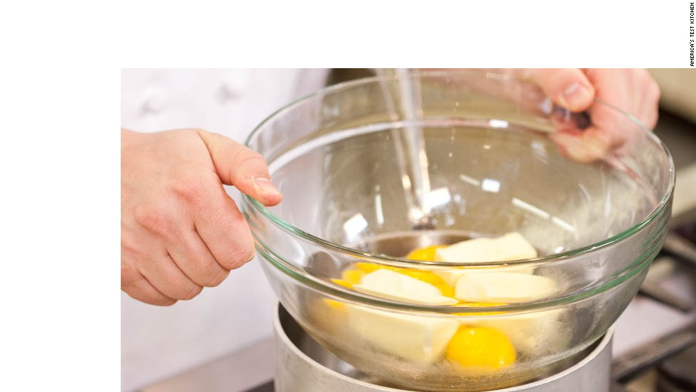 3. Set bowl over barely simmering water (don't let bowl touch water). Whisk eggs and butter together.