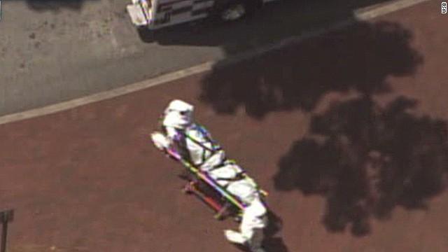 Ebola patient arrives on stretcher