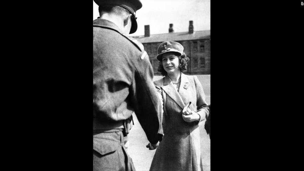 Princess Elizabeth shakes hands with an officer of the Grenadier Guards on May 29, 1942. King George VI made Elizabeth an honorary colonel in the Royal Army regiment.