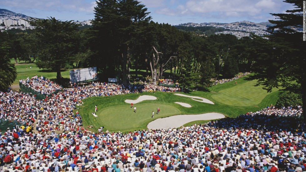 "This photo captures the spectacular natural amphitheater that surrounds the final green at The Olympic Club in San Francisco.<br /><br />The historic course is now almost a century old and was host of the 1987 U.S. Open -- where this image was taken.<br /><br />""The U.S. PGA only had to construct one small stand as everywhere else spectators were sitting on the natural slopes,"" Cannon says."