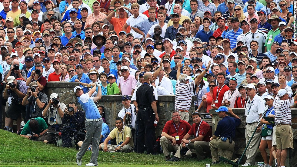 "Here we see McIlroy teeing off from the 10th hole during the final round of the 2011 U.S. Open at the Congressional Country Club in Bethesda, Maryland.<br /><br />A short time later, the 21-year-old Northern Irishman would stand on the 18th green and triumphantly lift his first major title.<br /><br />The win was all the more meaningful to McIlroy as it followed on from his final-day collapse at the Masters just a couple of months earlier.<br /><br />""He hit this shot literally inches from the hole,"" Cannon says. ""I love the way the whole crowd is following his ball, apart from the poor policeman and marshals doing their duties, that is."""