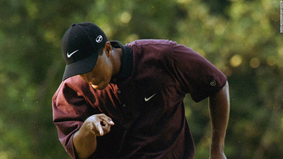"A pumped-up Tiger Woods holes a crucial putt during the 2000 U.S. PGA Championship playoff against Bob May at Valhalla. <br /><br />""This picture captured Tiger Woods at his absolute peak,"" Cannon says. <br /><br />""I never get tired of seeing Tiger will the ball into the hole, and this picture captures the way he almost appears to tell his ball what to do."""