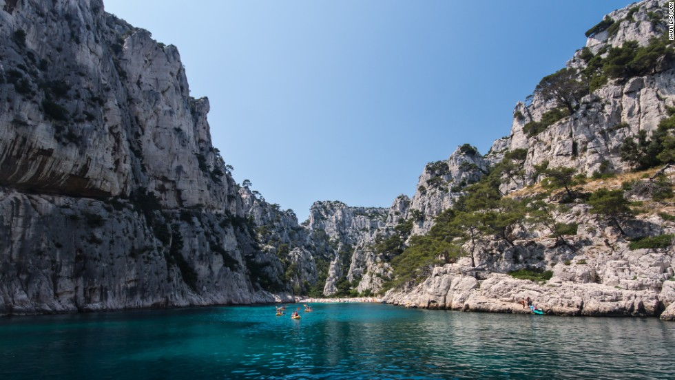 Calanque d'En Vau, along the Mediterranean coast of France between Cassis and Marseille, is one of a series of steep, narrow coves and inlets cutting into the shore. The beach can be reached on foot or by boat.