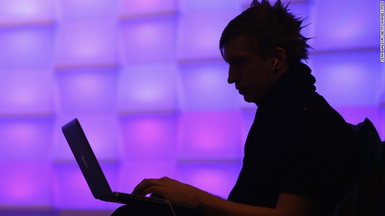 BERLIN, GERMANY - DECEMBER 28:  A participant sits with a laptop computer as he attends the annual Chaos Communication Congress of the Chaos Computer Club at the Berlin Congress Center on December 28, 2010 in Berlin, Germany. The Chaos Computer Club is Europe's biggest network of computer hackers and its annual congress draws up to 3,000 participants.  (Photo by Sean Gallup/Getty Images)