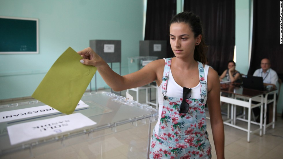 A Turkish national in Nicosia, Cyprus, casts her vote Friday, August 1. Turkish citizens in other countries have been able to cast their votes early.