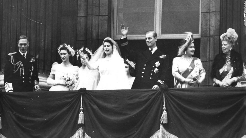 The Royal Wedding Party waves from the balcony of Buckingham Palace on November 20, 1947. After becoming a British citizen and renouncing his Greek title, Philip became His Royal Highness Prince Philip, Duke of Edinburgh. His wife became the Duchess of Edinburgh.