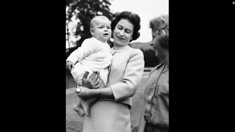 The Queen holds her son Prince Andrew while his sister, Princess Anne, watches during a family holiday at Scotland's Balmoral Castle in September 1960.