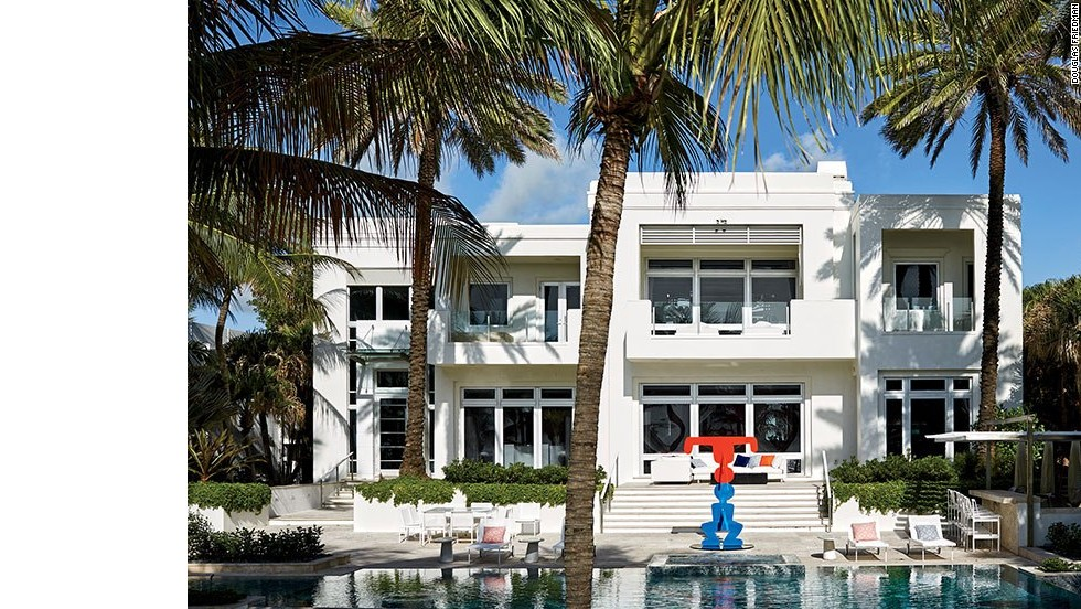 "The rear façade of the house. See more images at <a href=""http://www.architecturaldigest.com/celebrity-homes/2014/dee-and-tommy-hilfiger-florida-beach-house-slideshow?mbid=synd_cnn"" target=""_blank"">ArchitecturalDigest.com</a>"