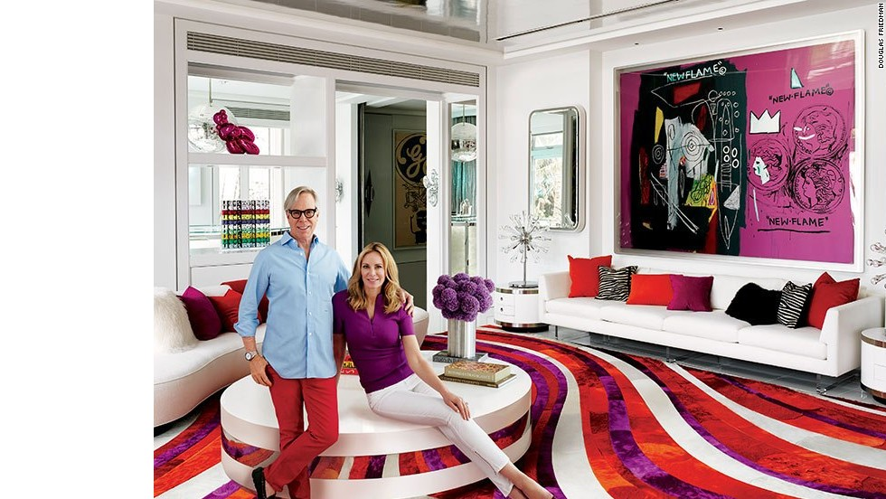 "Fashion designer Tommy Hilfiger and his wife, Dee, relax in the living room of their Miami-area home, which was decorated by Martyn Lawrence Bullard. A collaborative painting by Andy Warhol and Jean-Michel Basquiat sets the chromatic tone for the room, where Vladimir Kagan sofas from Ralph Pucci International join a vintage cocktail table from JF Chen, Willy Rizzo side tables, and a Kyle Bunting rug designed by Bullard. See more images at <a href=""http://www.architecturaldigest.com/celebrity-homes/2014/dee-and-tommy-hilfiger-florida-beach-house-slideshow?mbid=synd_cnn"" target=""_blank"">ArchitecturalDigest.com</a>"