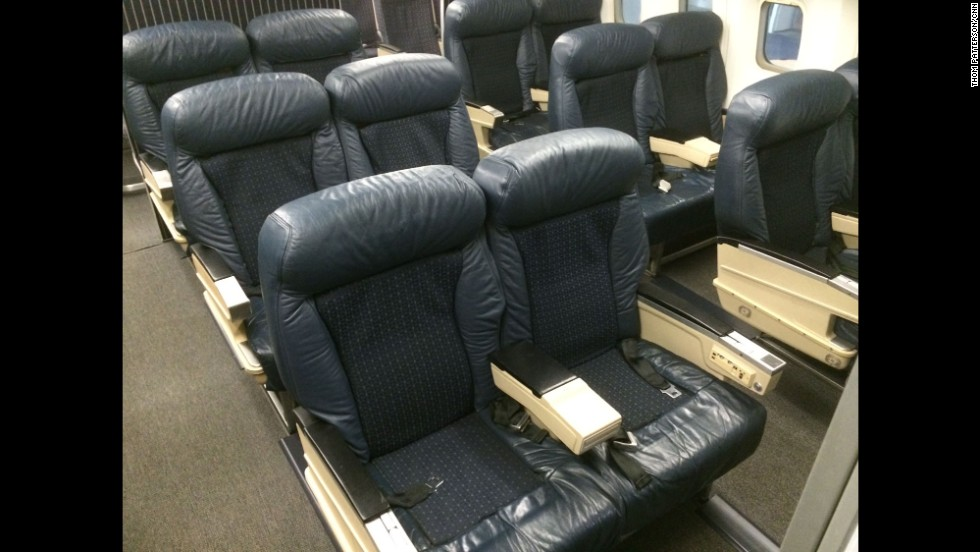 "Aboard the ""Spirit of Delta,"" visitors can walk through an airliner that's frozen in time, with old-style upholstery and armrests embedded with phones and audio controls."